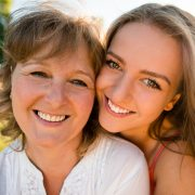 Mother and teenage daughter outdoor portrait